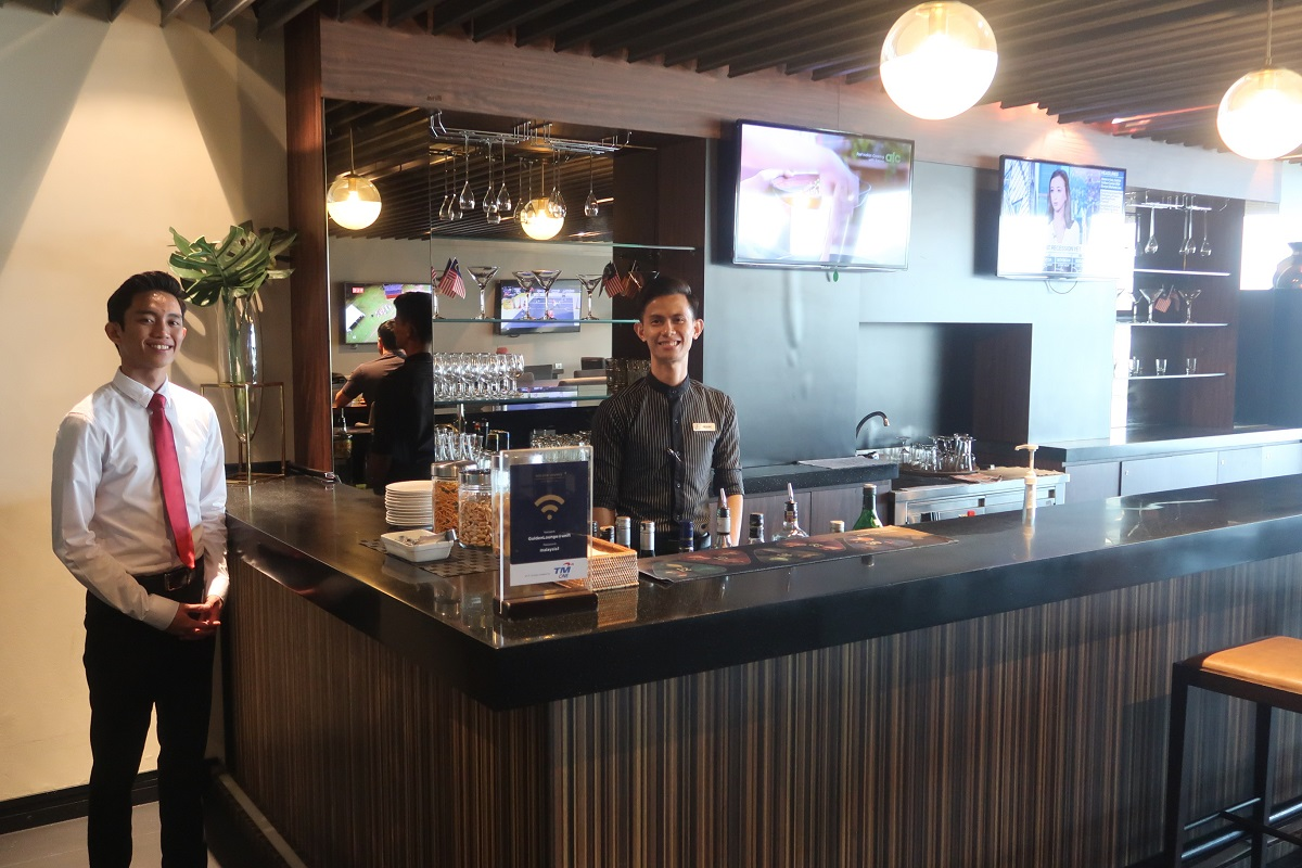 Malaysia Airlines KL Golden Lounge Satellite Terminal bar staff