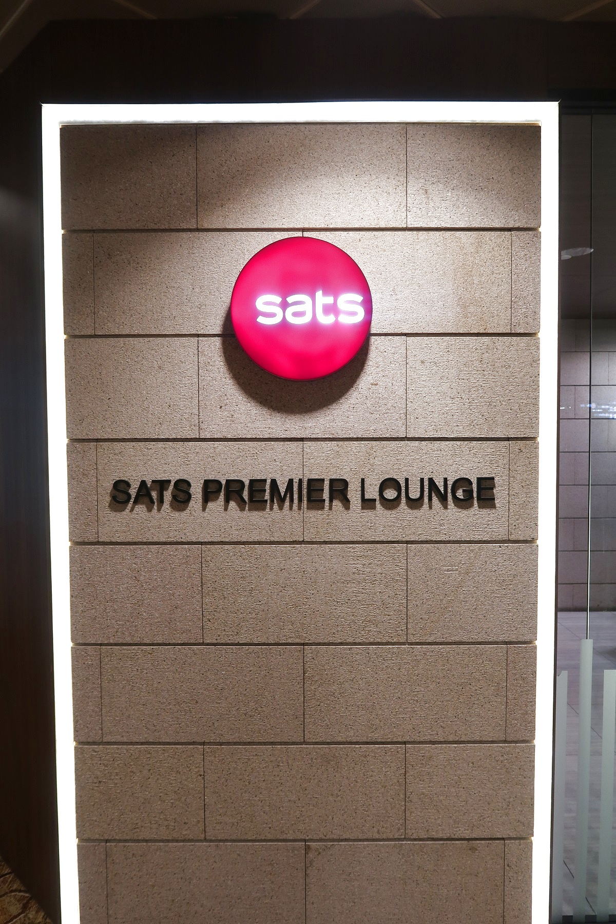 SATS Premier Lounge Terminal 2 Singapore Airport sign
